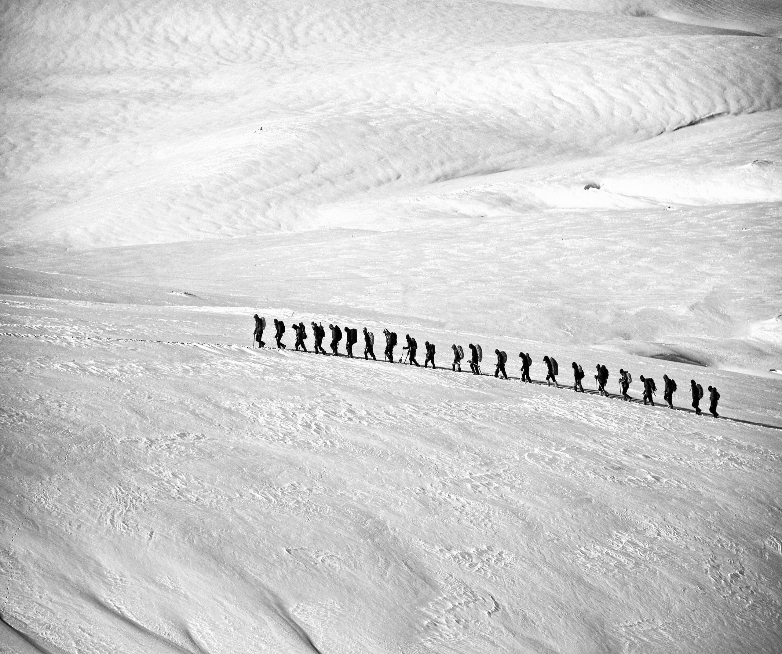 Queue of winter hikers